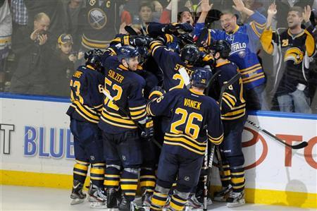 Buffalo Sabres players celebrate their overtime victory over the Montreal Canadiens during their NHL hockey game in Buffalo, New York March 12, 2012. REUTERS/Doug Benz