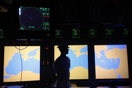 A U.S. Navy military personnel is pictured aboard the USS Monterey military vessel in the Black Sea harbour of Constanta, 250 km (155 miles) east of Bucharest June 7, 2011. The cruiser, equipped with the AEGIS air defense system, is the first phase of Adaptive Approach in Stages missile shield for Europe based in Romania. REUTERS/Bogdan Cristel