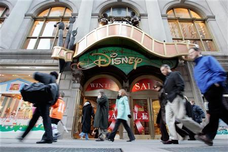 Passers-by walk in front of the World of Disney store in New York in this file photo taken January 19, 2006. REUTERS/Keith Bedford