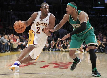 Los Angeles Lakers Kobe Bryant (L) drives on Boston Celtics Paul Pierce during their NBA basketball game in Los Angeles, California March 11, 2012. REUTERS/Lucy Nicholson