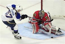 Chicago Blackhawks' goalie Corey Crawford makes the game-winning save off St. Louis Blues' David Perron during the shoot out of their NHL hockey game in Chicago, March 13, 2012. REUTERS/Jim Young