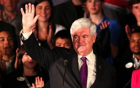 Republican U.S. presidential candidate and former Speaker of the House Newt Gingrich waves to supporters at the conclusion of his speech at his Alabama and Mississippi primary election night rally in Hoover, Alabama, March 13, 2012
