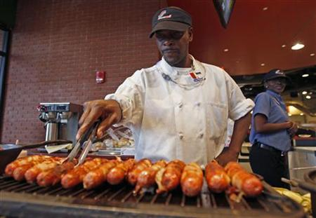 A vendor cooks hot dogs as fans enter Busch Stadium before the start of play between the Texas Rangers and the St. Louis Cardinals in Game 1 of MLB's World Series baseball championship in St. Louis, Missouri, October 19, 2011. REUTERS/Jeff Haynes