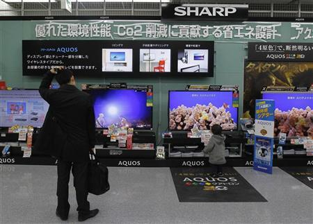 A man looks around Sharp's TV sets at an electronics store in Tokyo February 1, 2012. REUTERS/Kim Kyung-Hoon