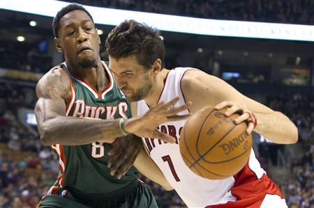 Toronto Raptors Andrea Bargnani (R) drives to the basket against Milwaukee Bucks Larry Sanders in the first half of their NBA basketball game in Toronto March 11, 2012. REUTERS/Fred Thornhill