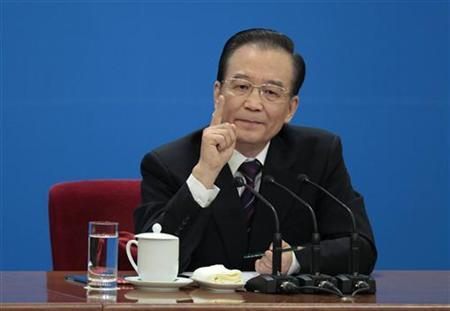 China's Premier Wen Jiabao gestures as he delivers a speech at a news conference in Beijing, March 14, 2012. REUTERS/Jason Lee