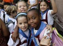 School children pose before lessons start in Nicolas Estevanez Primary School in Havana September 28, 2011. REUTERS/Desmond Boylan