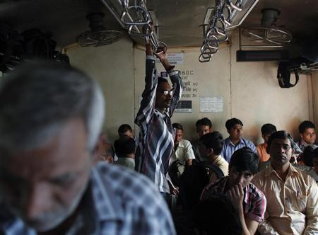 Commuters travel in a crowded suburban train during the morning rush hour in Mumbai March 14, 2012. REUTERS/Danish Siddiqui/Files