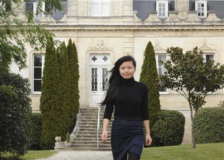 Li Lijuan, the 28-year old Chinese woman in charge of managing the Grand Moueys property in the absence of Chinese businessman Jin Shan Zhang, walks in front of the Chateau du Grand Moueys in Capian March 7, 2012.  REUTERS/Caroline Blumberg