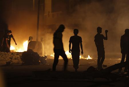 Anti-government protesters are seen during clashes in the village of Diraz, west of Manama, March 13, 2012. REUTERS/Hamad I Mohammed