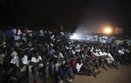 Residents watch the premiere of ''Kony 2012'', a 30-minute YouTube film created by the nonprofit group Invisible Children, in Lira district located 376 km (234 miles) north of Uganda's capital Kampala March 13, 2012. REUTERS/James Akena