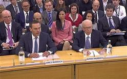 News International Chairman James Murdoch (front L), and his father Rupert Murdoch, are seen appearing before parliamentarian in London in this July 19, 2011 file photograph. REUTERS/Parbul TV via Reuters TV/Files