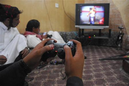 Saudi Arabian men play video games, at a guest thouse in the city of Tabuk March 10, 2012. The Middle East has one of the fastest growing communities of online gamers in the world, and demographics mean this is likely to remain true for many years. REUTERS/Stringer