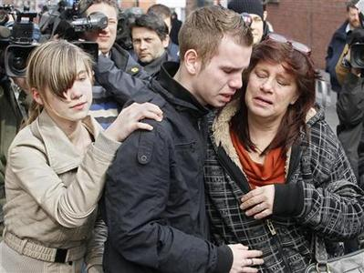 Relatives, parents and teachers arrive at the Sint Lambertus school in Belgium, March 14, 2012. A bus carrying Belgian tourists crashed into the wall of a tunnel in Sierre in the Valais region of Switzerland, killing 28 people, 22 of them children, police said on Wednesday. The bus, transported 52 people, mostly school children from Heverlee and Lommel in Flanders. REUTERS/Yves Herman
