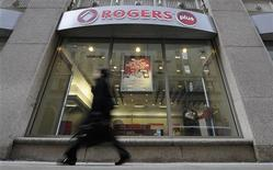A woman walks by a Rogers Plus store in Toronto February 16, 2011. REUTERS/Mark Blinch