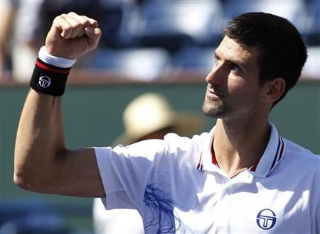 Novak Djokovic of Serbia celebrates defeating Pablo Andujar of Spain in their match at the Indian Wells ATP tennis tournament in Indian Wells, California March 14, 2012. REUTERS/Danny Moloshok