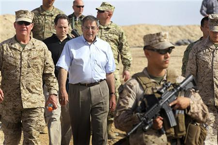 U.S. Secretary of Defense Leon Panetta (C) leaves after visiting with troops from the 31st BN Light Infantry of the Georgian Army at Forward Operating Base Shukvani, March 14, 2012. Panetta told troops in Afghanistan on Wednesday that the massacre of 16 Afghan civilians by an American soldier should not deter them from their mission to secure the country ahead of a 2014 NATO withdrawal deadline. REUTERS/Scott Olson/Pool