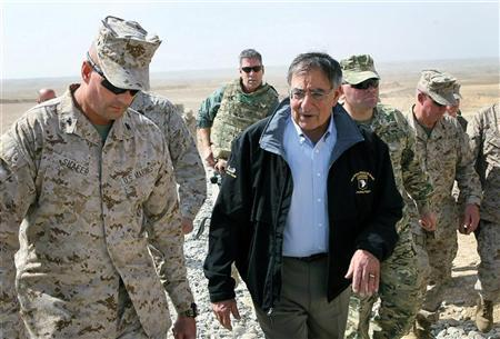 U.S. Defense Secretary Leon Panetta is greeted by Col. John Shafer (L) with RTC 6 after arriving to greet troops at Foward Operating Base Shukvani, Afghanistan March 14, 2012. REUTERS/Scott Olson/Pool