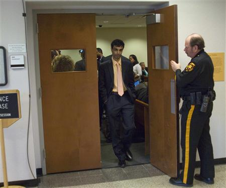 Dharun Ravi (L), a Rutgers University student charged with bias intimidation, leaves the courtroom while the jury goes into deliberations in the Superior Court of New Jersey in Middlesex County, New Brunswick March 14, 2012. A jury on Wednesday began deciding whether Ravi committed a hate crime when he used a webcam to spy on his college roommate Tyler Clementi kissing another man in a case that put a national spotlight on gay bullying when Clementi committed suicide days later. REUTERS/ Mark Dye