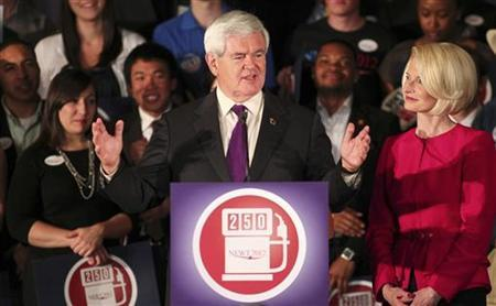 Republican U.S. presidential candidate and former Speaker of the House Newt Gingrich speaks to supporters as his wife Callista (R) joins him onstage at his Alabama and Mississippi primary election night rally in Hoover, Alabama, March 13, 2012. REUTERS/Marvin Gentry