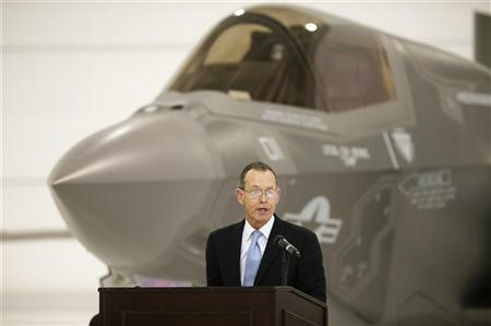 Chairman and CEO of Lockheed Martin, Robert Stevens speaks in front of a U.S. Marine F-35B Joint Strike Fighter Jet during the roll-out ceremony at Eglin Air Force Base in Florida February 24, 2012. REUTERS/Michael Spooneybarger