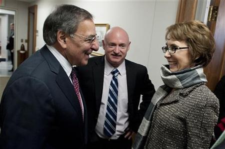 Secretary of Defense Leon Panetta (L) greets former U.S. Rep. Gabrielle Giffords and her husband, Mark Kelly, at the Pentagon in Virginia in this handout taken February 10, 2012, and released to Reuters February 13, 2012. REUTERS/Chad J. McNeeley/Department of Defense/Handout