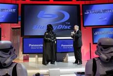 "Twentieth Century Fox Home Entertainment President Mike Dunn (R) talks to ""Darth Vader"" as he announces the Blu Ray release of the complete Star Wars movie saga during the first day of the 2011 International Consumer Electronics Show (CES) in Las Vegas, Nevada January 6, 2011. REUTERS/Steve Marcus"