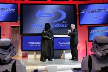 Twentieth Century Fox Home Entertainment President Mike Dunn (R) talks to ''Darth Vader'' as he announces the Blu Ray release of the complete Star Wars movie saga during the first day of the 2011 International Consumer Electronics Show (CES) in Las Vegas, Nevada January 6, 2011. REUTERS/Steve Marcus