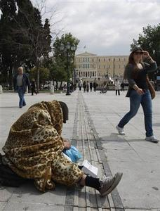 A homeless man begs at the central Syntagma (Constitution) Square, with the parliament pictured in the background, in Athens March 15, 2012. Greece's jobless rate rose to 20.7 percent in the fourth quarter of 2011 from 17.7 percent in the previous three-month period as economic activity slumped, the country's statistics service said on Thursday. It was the highest quarterly unemployment rate since this data series started in 1998. REUTERS/John Kolesidis