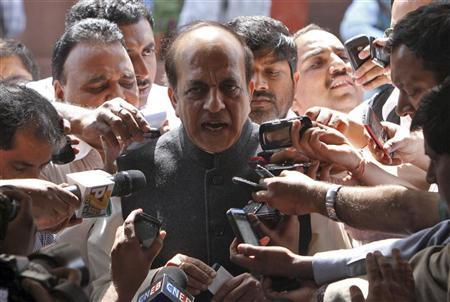 Railways Minister Dinesh Trivedi speaks with the media outside the parliament in New Delhi March 15, 2012. REUTERS/B Mathur