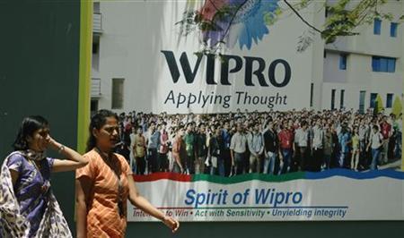 People walk in the Wipro campus in Bangalore June 23, 2009. REUTERS/Punit Paranjpe/Files