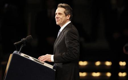 New York Governor Andrew Cuomo pauses as he is being applauded before his State of the State address at the Empire State Plaza Convention center in the New York State Capitol complex in Albany, New York, January 5, 2011. REUTERS/Mike Segar