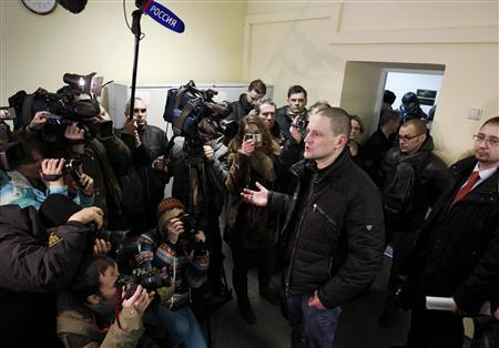 Opposition activist and Left Front movement leader Sergei Udaltsov (C) talks to the media before hearings at a court session in Moscow March 15, 2012. REUTERS/Anton Golubev
