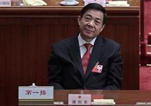 Бо Силай на церемонии закрытия Всекитайского собрания народных представителей в Пекине, 14 марта 2012 г. Амбициозный претендент на руководство Китайской коммунистической партией Бо Силай был уволен с должности главы города Чунцин, что выявило нарастающие идеологические разногласия в партии как раз тогда, когда новое поколение готовится встать у руля. REUTERS/Jason Lee