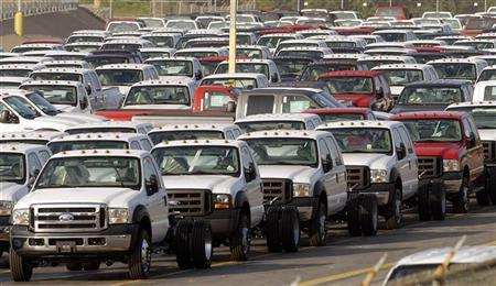 Ford heavy duty trucks and F series trucks are parked at a lot at the Louisville Ford Truck Plant in Louisville, Kentucky, September 15, 2006 REUTERS/John Sommers II