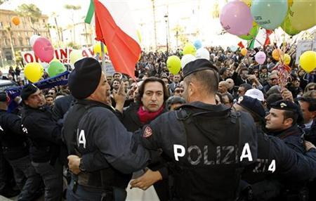 A lawyer is held back by policemen during a protest in front of the Justice Palace in Rome March 15, 2012. REUTERS/Alessandro Garofalo