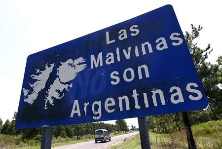A vehicle passes by a sign that reads ''The Malvinas (Falklands) are Argentine'' on Route 136, near the Argentine city of Gualeguaychu, February 19, 2012. REUTERS/Marcos Brindicci
