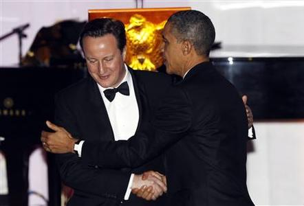 U.S. President Barack Obama and British Prime Minister David Cameron embrace after a toast during the State Dinner at the White House in Washington March 14, 2012. REUTERS/Kevin Lamarque