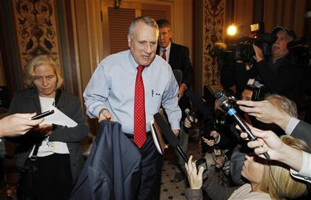 Senator Jon Kyl (R-AZ) departs a ''super committee'' meeting in the Capitol in Washington November 18, 2011. REUTERS/Kevin Lamarque