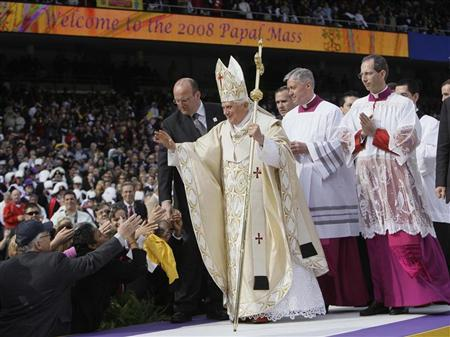 Pope Benedict XVI greets Catholic faithful as he exits the altar after celebrating Mass at Yankee Stadium in New York April 20, 2008. REUTERS/Julie Jacobson/Pool