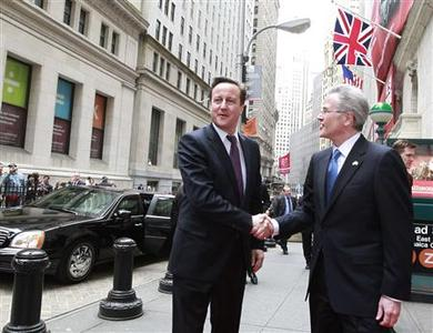 Britain's Prime Minister David Cameron (L) is greeted by Jeffrey Eubank, Senior Vice President of Global Affairs for NYSEEuronext, as he arrives at the New York Stock Exchange, March 15, 2012. REUTERS/Brendan McDermid