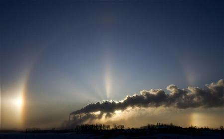 A gas fired power station is seen on the outskirts of Minsk, with a rainbow and sun rays in the sky, December 15, 2009. REUTERS/Vasily Fedosenko