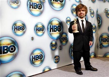 Peter Dinklage, winner of the award for best performance by an actor in a supporting role in a series, mini-series or motion picture made for television, for ''Game of Thrones,'' holds his award at the HBO after party at the 69th annual Golden Globe Awards in Beverly Hills, California January 15, 2012. REUTERS/Danny Moloshok