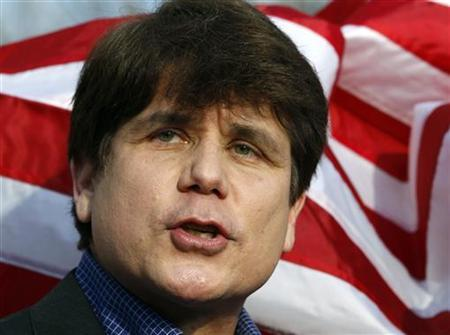 Former Illinois Governor Rod Blagojevich makes a statement to reporters outside his Chicago home one day before reporting to federal prison in Colorado to serve a 14-year sentence for corruption, March 14, 2012. REUTERS/Jeff Haynes