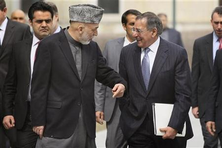 United States Secretary of Defense Leon Panetta (R) talks with Afghanistan President Hamid Karzai during a visit to the Presidential Palace in Kabul March 15, 2012. REUTERS/Scott Olson/Pool