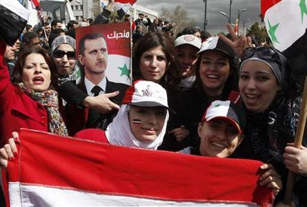Supporters of Syria's President Bashar al-Assad attend a rally at Umayyad square in Damascus March 15, 2012. Several government rallies took place across the country for support of Assad. REUTERS/Khaled al-Hariri