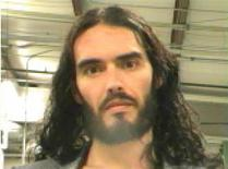 British actor Russell Brand is pictured in this booking photograph handout released by the Orleans Parish Sheriff's Office March 15, 2012. REUTERS/Orleans Parish Sheriff's Office/Handout