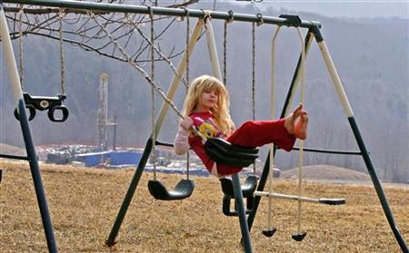 Rachel Farnelli rides on her backyard swing that overlooks the Gesford #3 natural gas well in Dimock, Pennsylvania, in this March 7, 2009 file photo. REUTERS/Tim Shaffer/Files