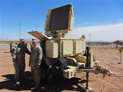 Soldiers from Fort Hood, Sgt. Mark Stark (L) and Specialist Zach Janzen, stand next to the Sentinel radar system recently deployed in Douglas, Arizona March 15, 2012. A highly specialized U.S. military task force is helping federal police hunt elusive drug traffickers slipping over the Mexico border in hard-to-detect utlralight aircraft, officials said on Thursday. REUTERS/Curt Prendergast