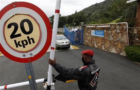 A security guard keeps watch at the entrance of King David School High School in suburban Johannesburg, March 15, 2012. Smith was a principled and competitive student, the kind of person whose strong sense of right and wrong probably pushed him to resign from Goldman Sachs in a scathing letter to an international newspaper, his former teacher and coach said. REUTERS/Siphiwe Sibeko